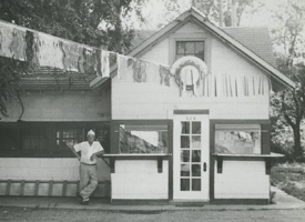 Man and historic Paradise Donut shop